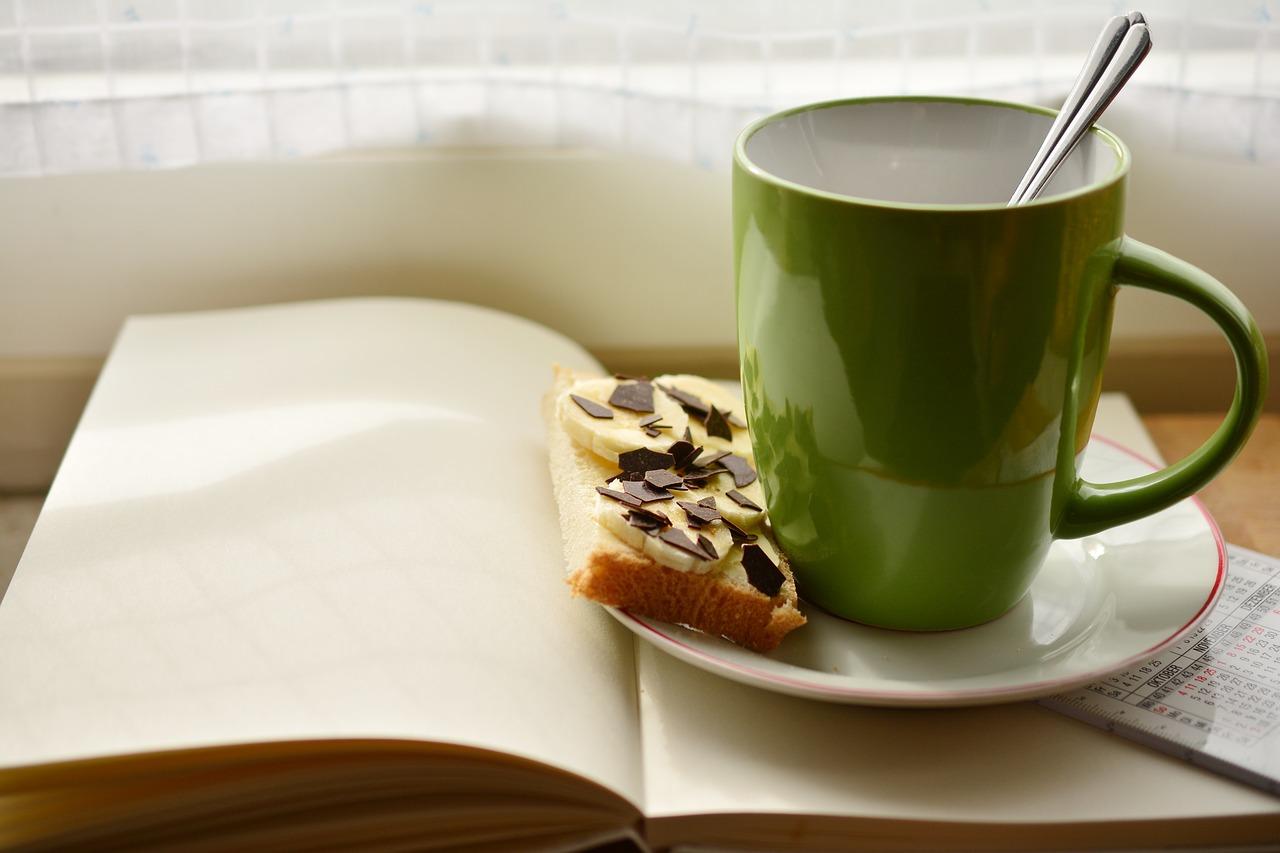 cup, a book, breakfast-2123710.jpg